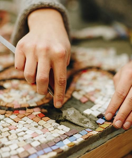 Close-up of the process of crafting a mosaic