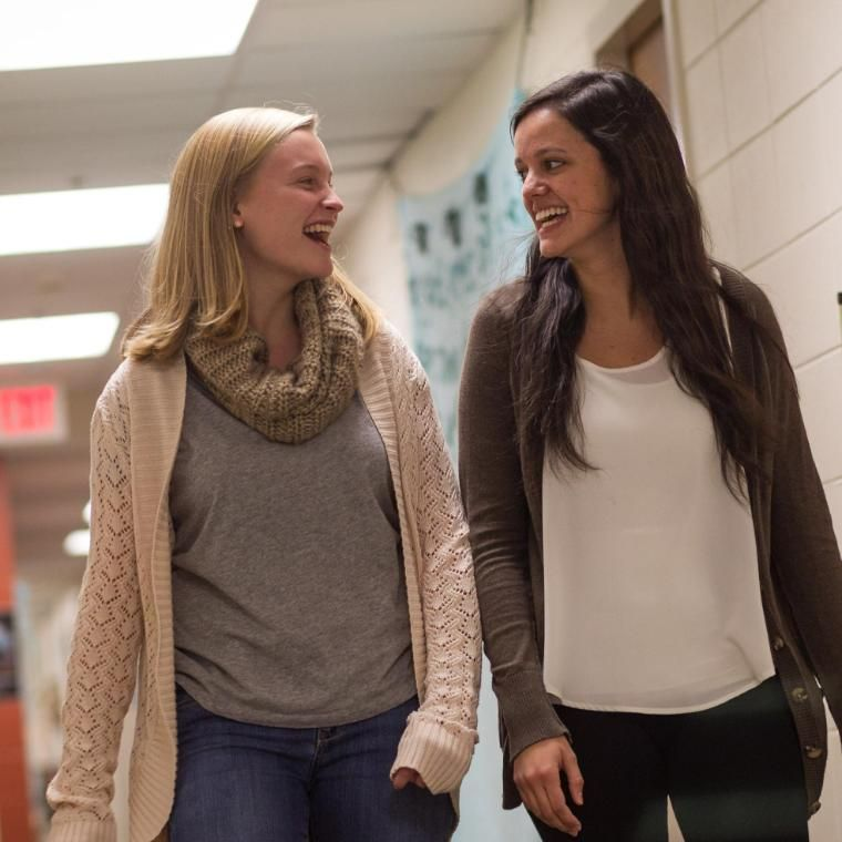 Two Female Wheaton College Students walking down the hall