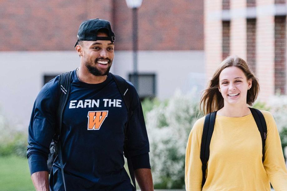 Two Wheaton Students Walking Outside