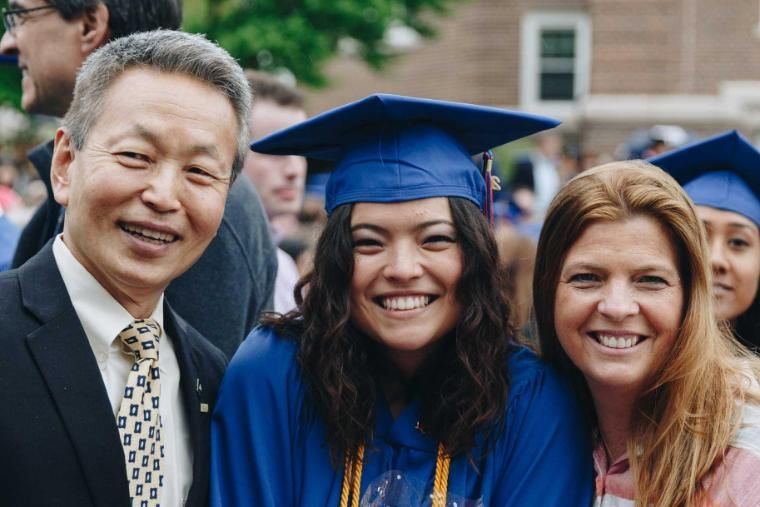 Wheaton Graduate with her Parents on Graduation Day