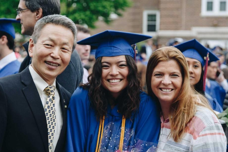 wheaton graduate with her parents