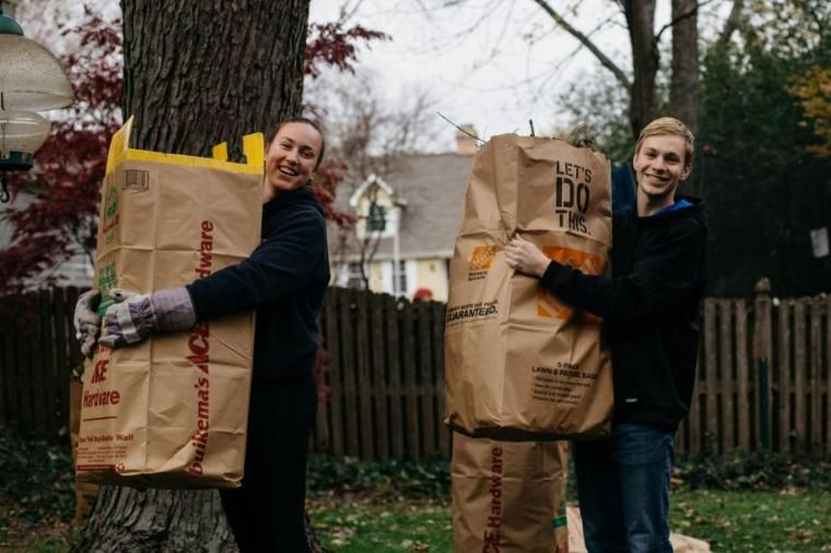 Wheaton College IL Students Carrying Bags of Leaves for Service Project
