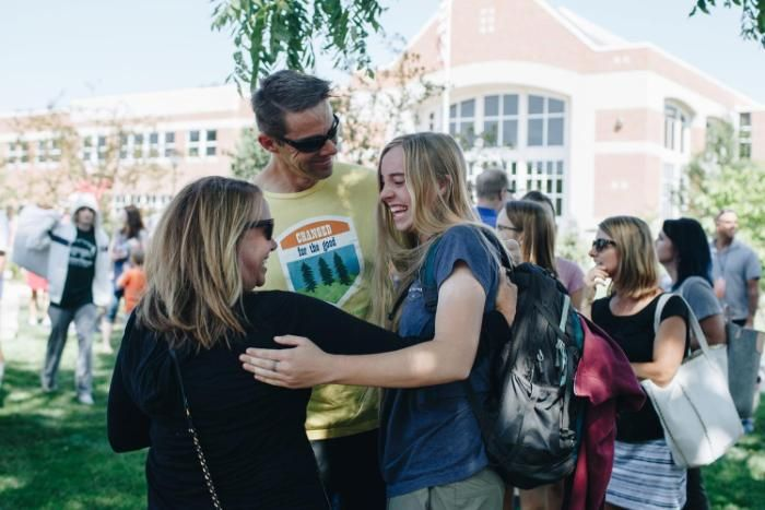 Wheaton College IL student with her parents outside