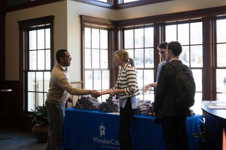Visitors Being Welcomed to the Wheaton College IL Welcome Center