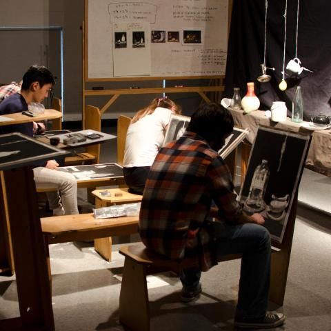 Students drawing in the Drawing Room