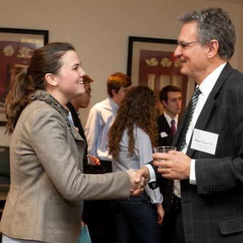 Business and Economics student networking with a Wheaton College alumni