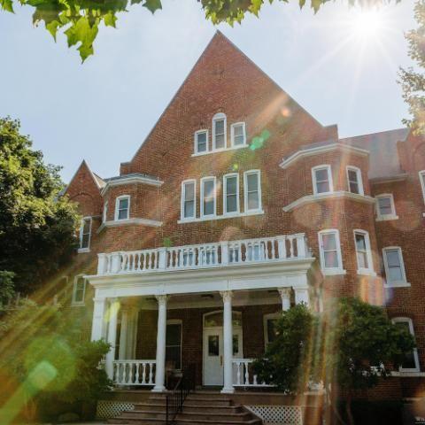 Williston Hall with sunbeams