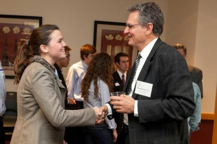 Wheaton College IL Student Shaking Hands with Alumnus at Career Networking Event