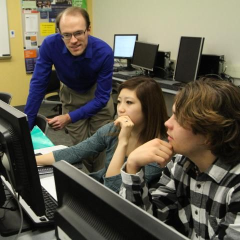 Dr. Devin Pohly teaching students in computer science class