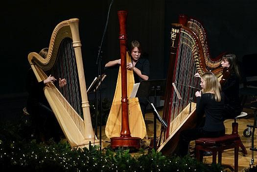 3 Harpists performing during the Christmas Festival Concert