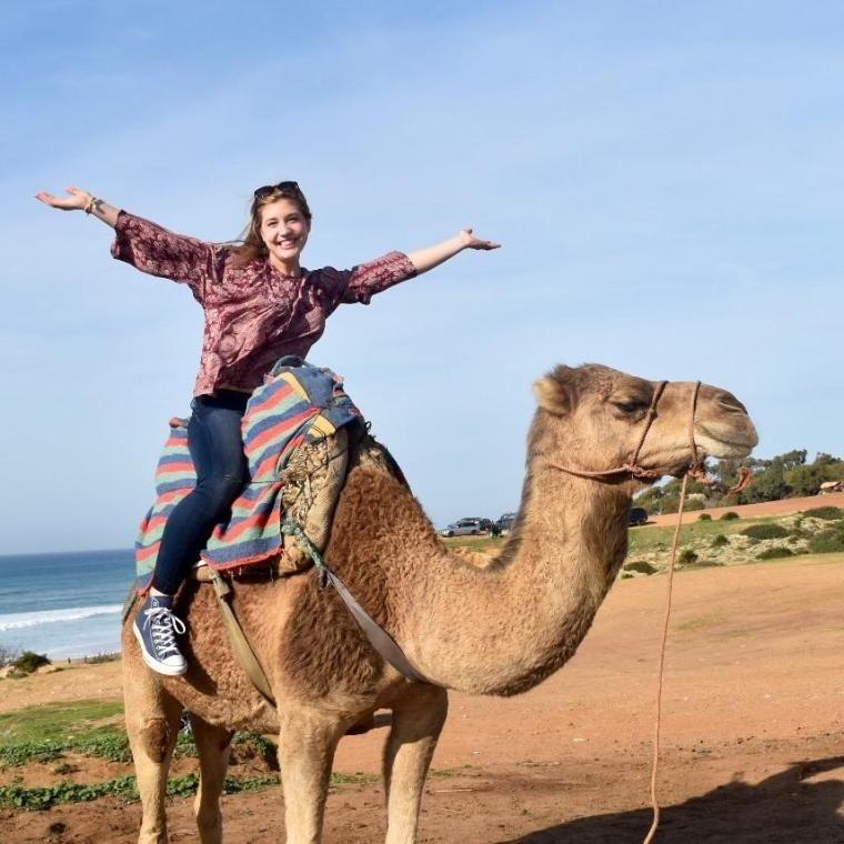 Wheaton College IL Student riding camel