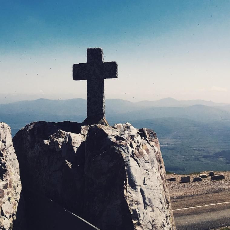 cross on top of rocky hill