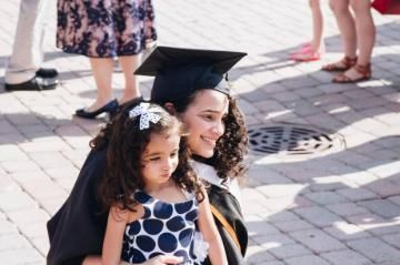a woman and a child smiling at commencement