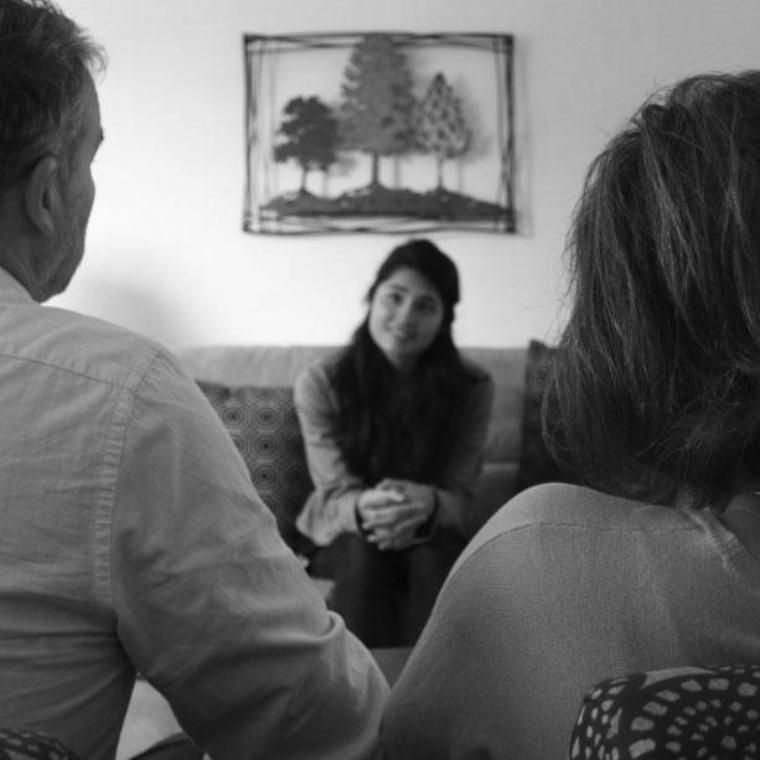 A woman counseling a married couple