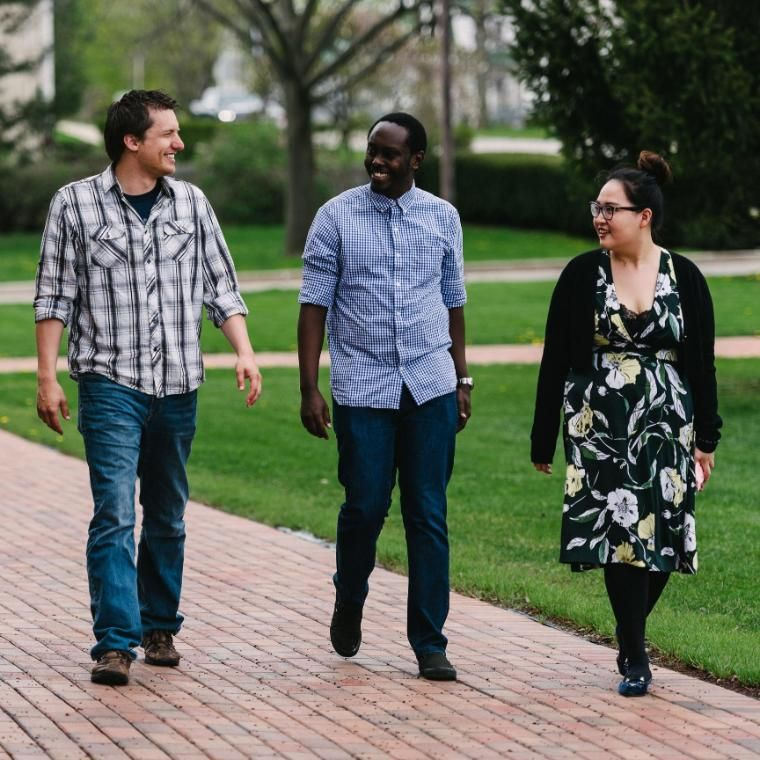Four Wheaton College Graduate School students walking together