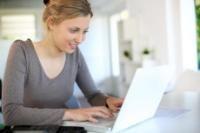 woman sitting at a laptop