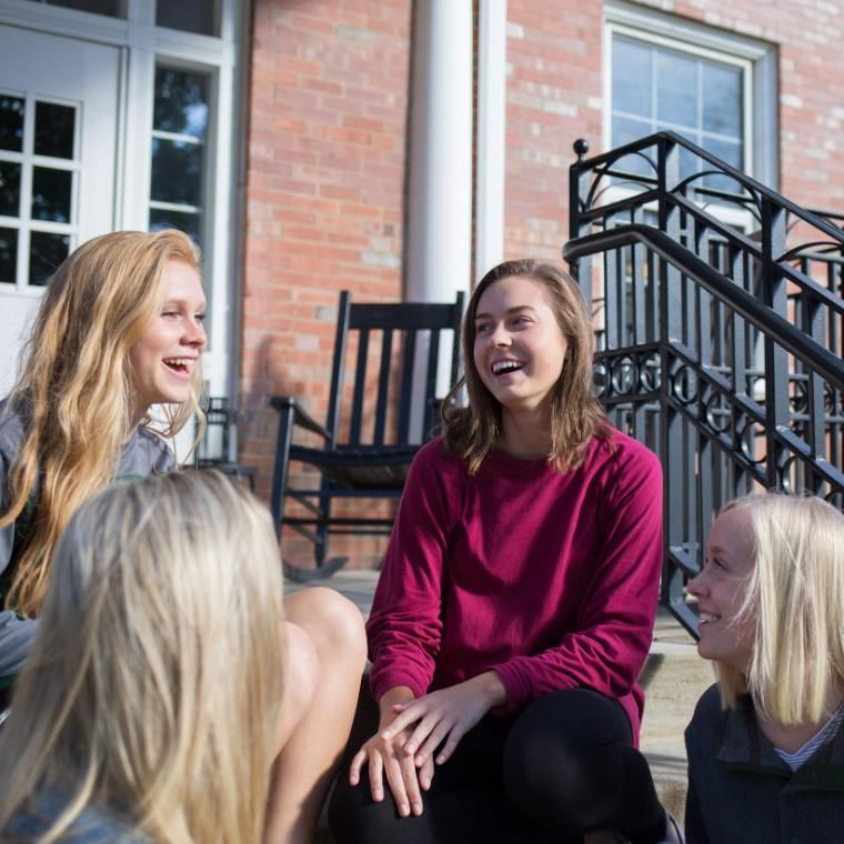 Wheaton College Graduate Resident Assistant with students on MacEvans Porch