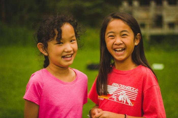 camper girls smiling at HoneyRock in Three Lakes, WI