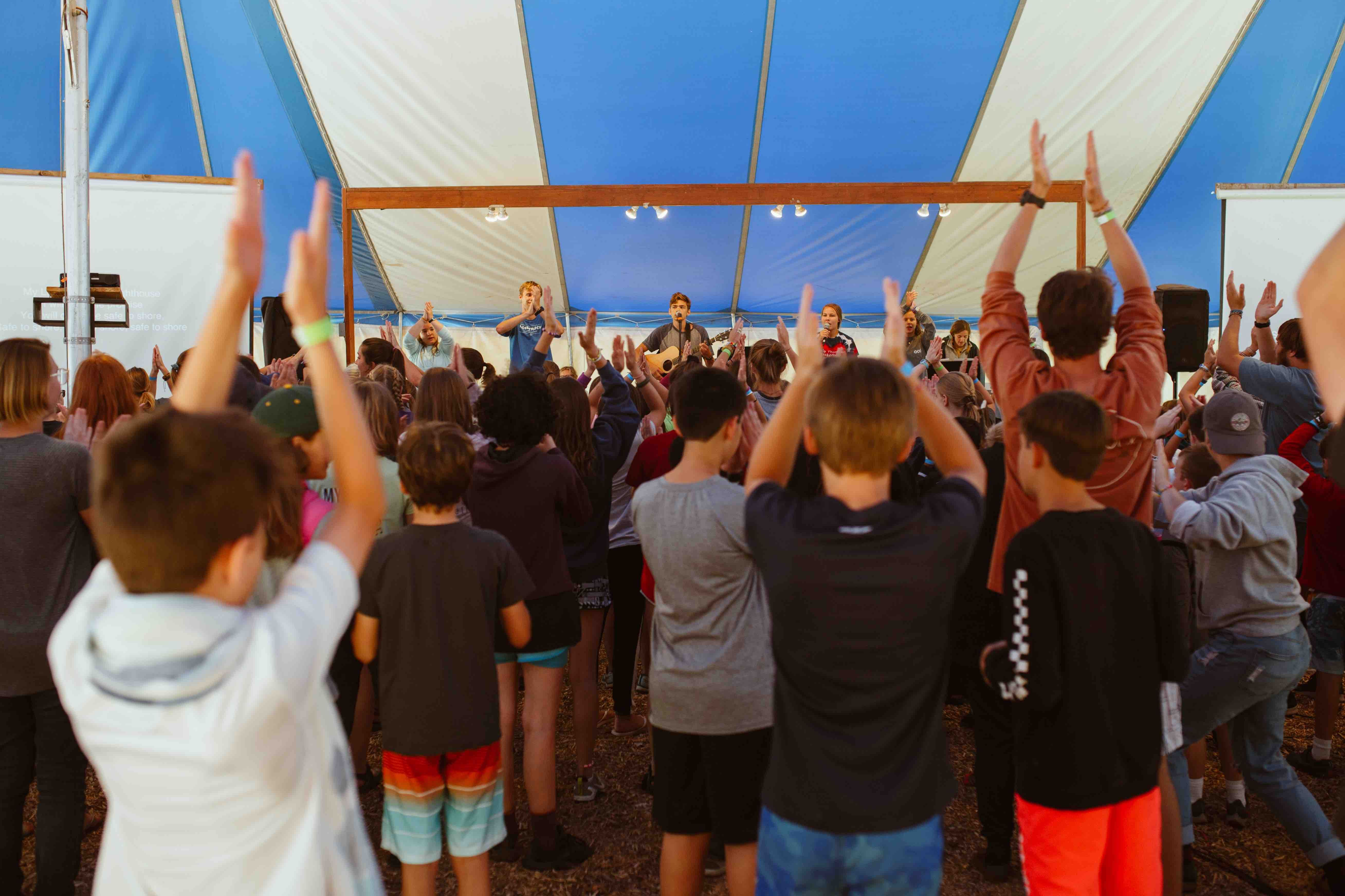 Campers worship through singing every day!