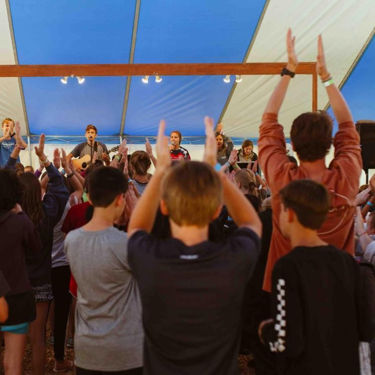 Before the first activity period, Res campers go to camper worship in the blue and white tent. This is often a highlight for campers as they sing and praise God through song.