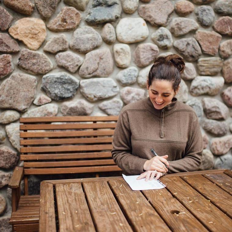 woman writing at honeyrock