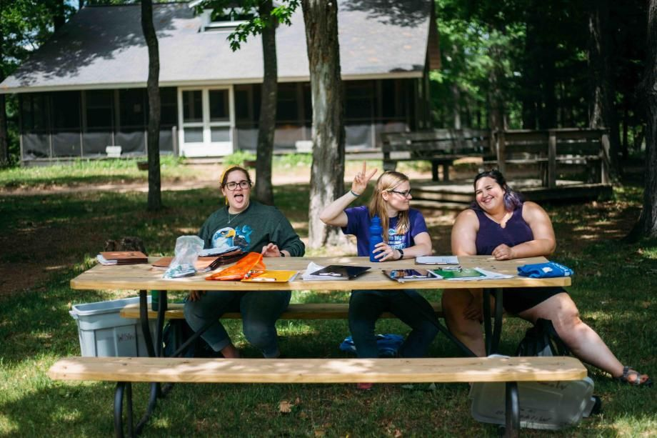 team of summer staff at picnic bench