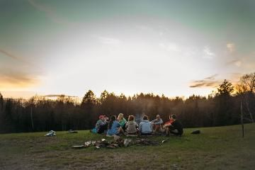 group of vanguards around a campfire at honeyrock in three lakes wi
