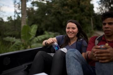 vanguard rides in truck with a local in the dominican republic on international trip