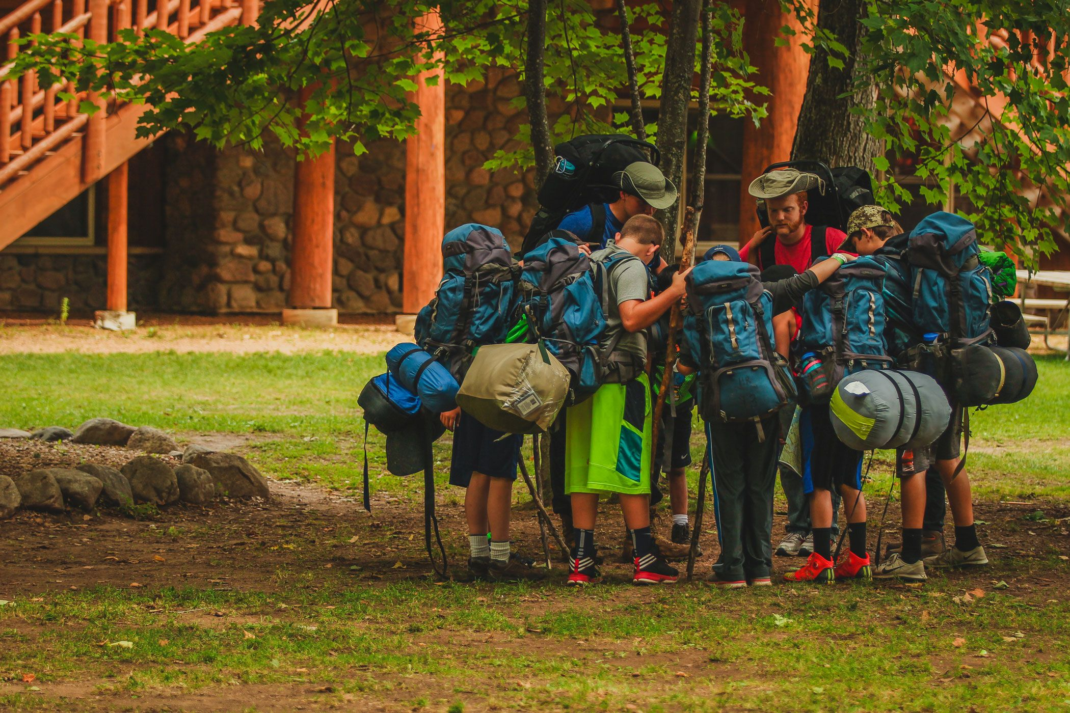 Campers gather in a circle before they depart to pray.