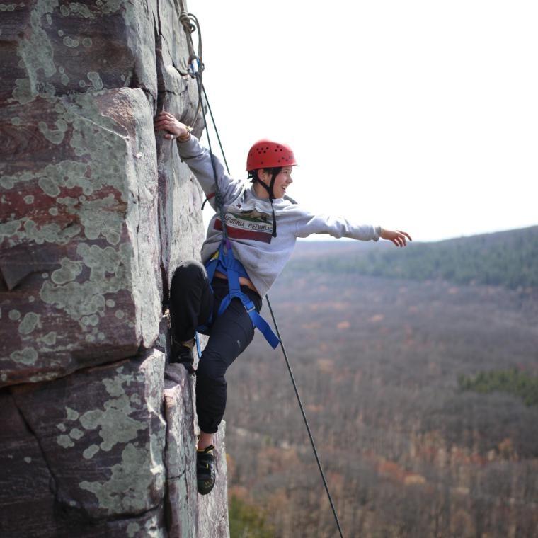 vanguard climbing a rock face