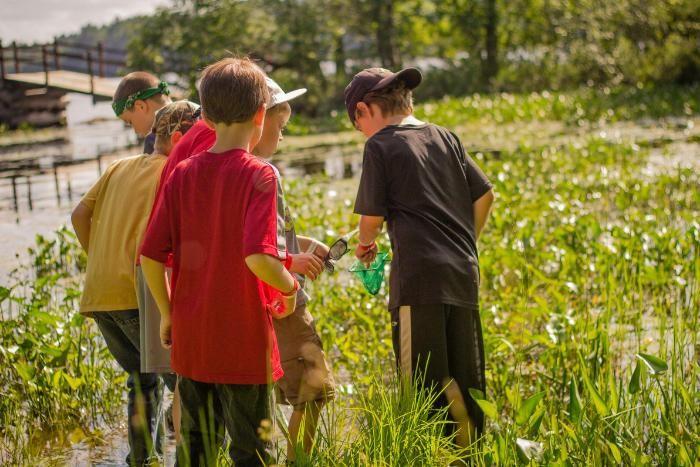 boys explore the HoneyRock lagoon
