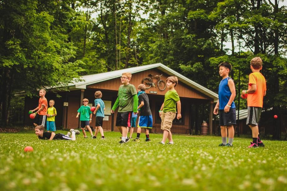 campers playing a game on the lawn