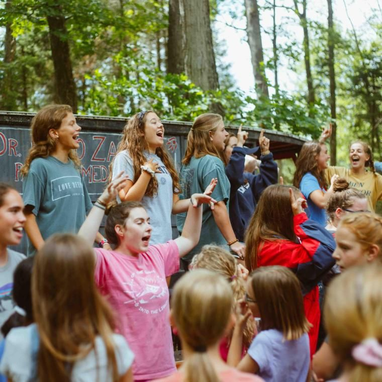 """After waking up and getting ready for the day, campers go to the """"Zacco Wagon"""" to sing a few crazy songs before eating breakfast. This happens before every meal and is often shortened to """"Zacco"""" and is pronounced """"Zack-O""""."""