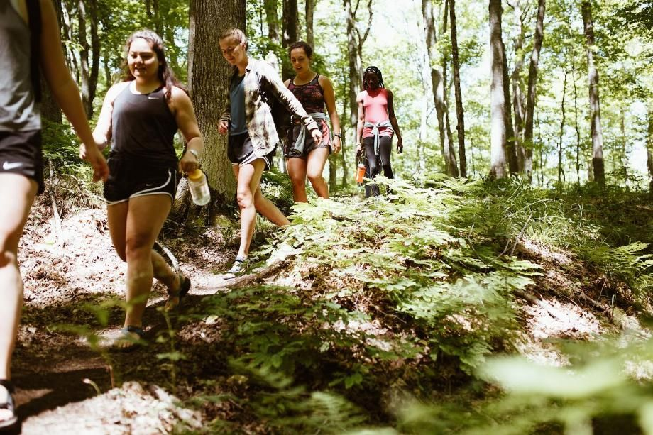 women hiking in forest
