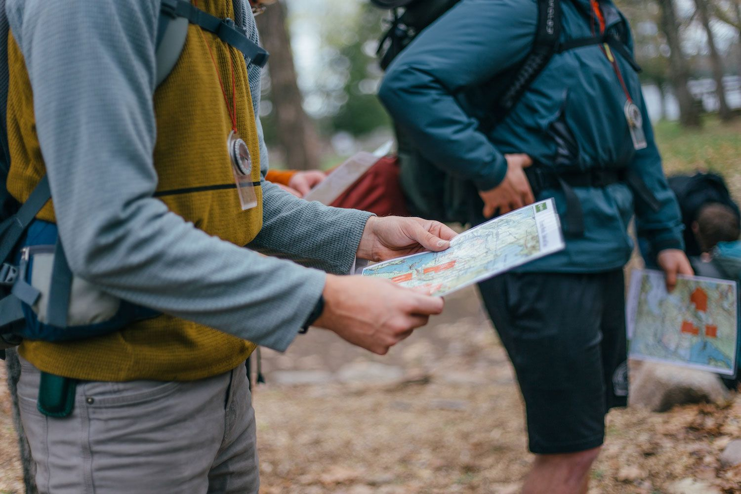 Under the guidance of their cabin leaders, campers follow trail signs to make their way to their campsites.