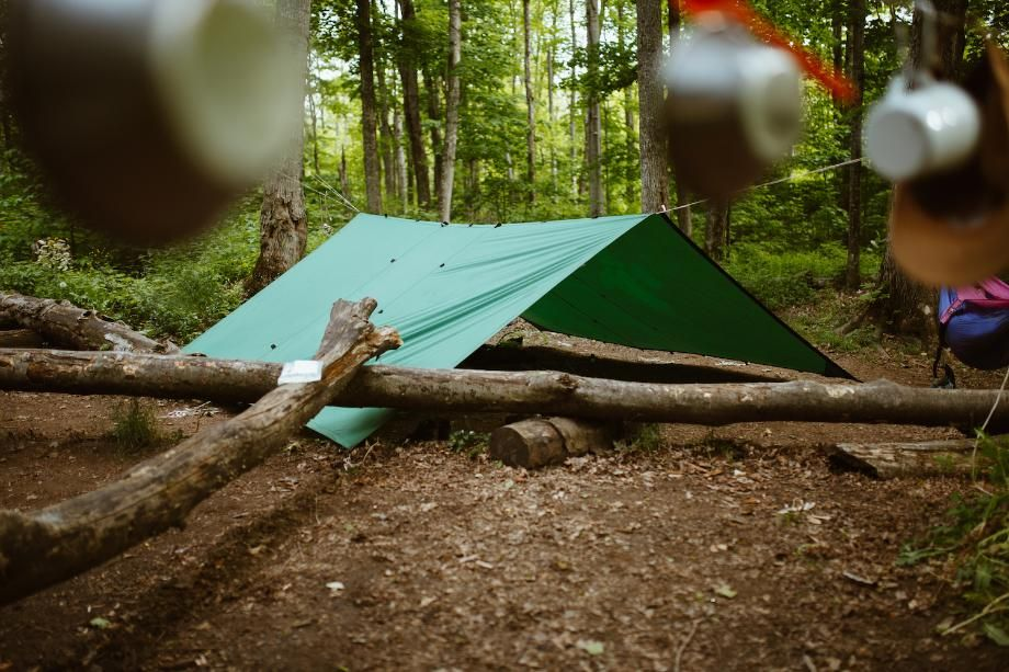 tent shelter set up in woods Our People Variant
