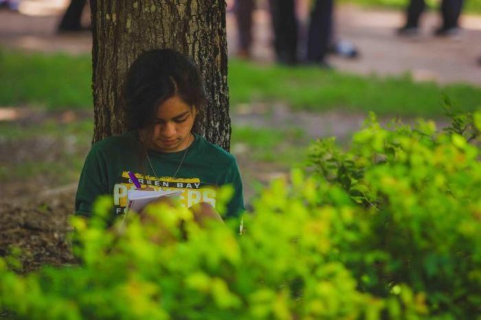 camper journaling at honeyrock