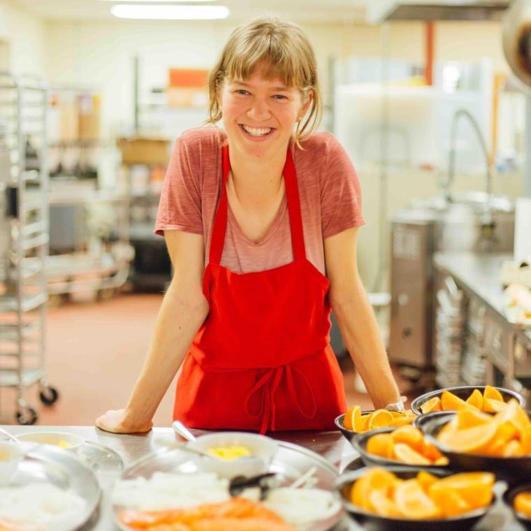 vanguard sarah lambert serving oranges and smiling