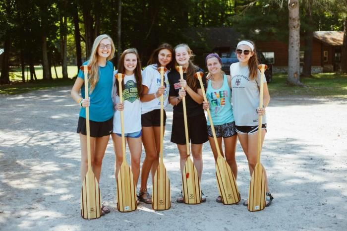 voyageur campers standing with paddles