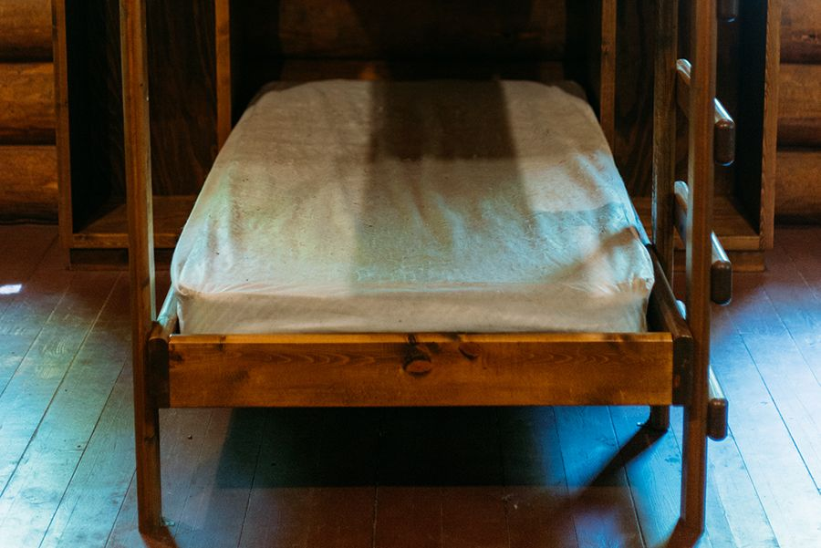 The bunk beds have waterproof covers to keep the space sanitary and easy to clean.