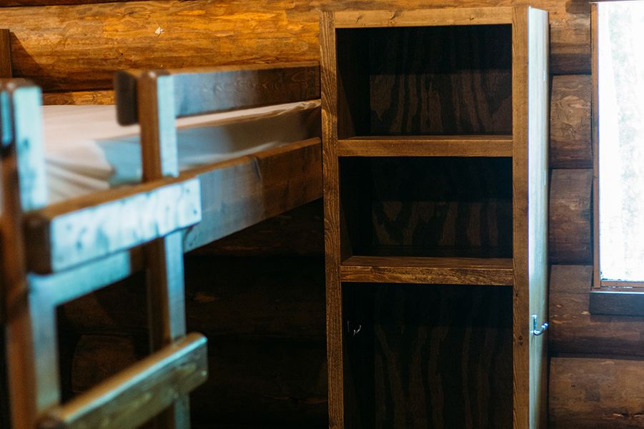 Upon arrival, campers can choose their own bunk beds. The top bunks have rails to ensure campers sleep safely and securely.