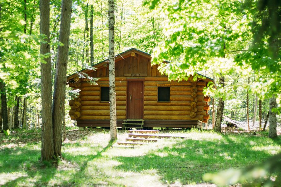 All of the cabins are in the woods and some have lakefront views. There are clearly marked and easily walkable paths for campers to walk to the bathrooms, dining hall, and activity areas.
