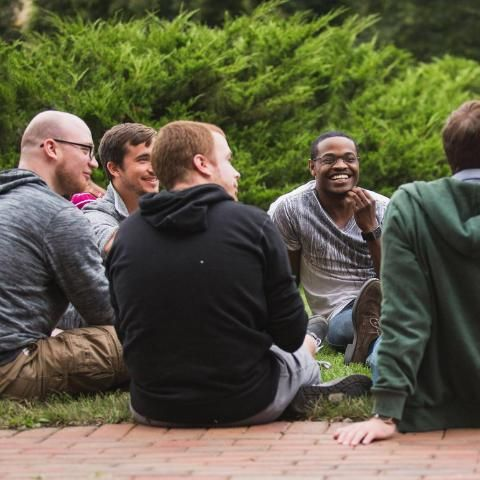 Graduate students having a picnic on the front campus