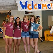 students smiling in welcome 184x184