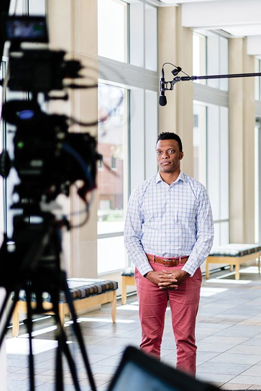 Wheaton made the historic decision to postpone Commencement ceremonies, but hosted virtual events to recognize the achievements of its graduates. Pictured is Dr. Theon HIll, Assistant Professor of Communication, being filmed for the virtual events.