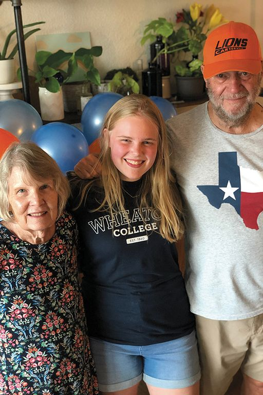 Mary Bonnell is pictured with her grandparents, Neal Whitecotton '63 and Judi Hamer Whitecotton '64.