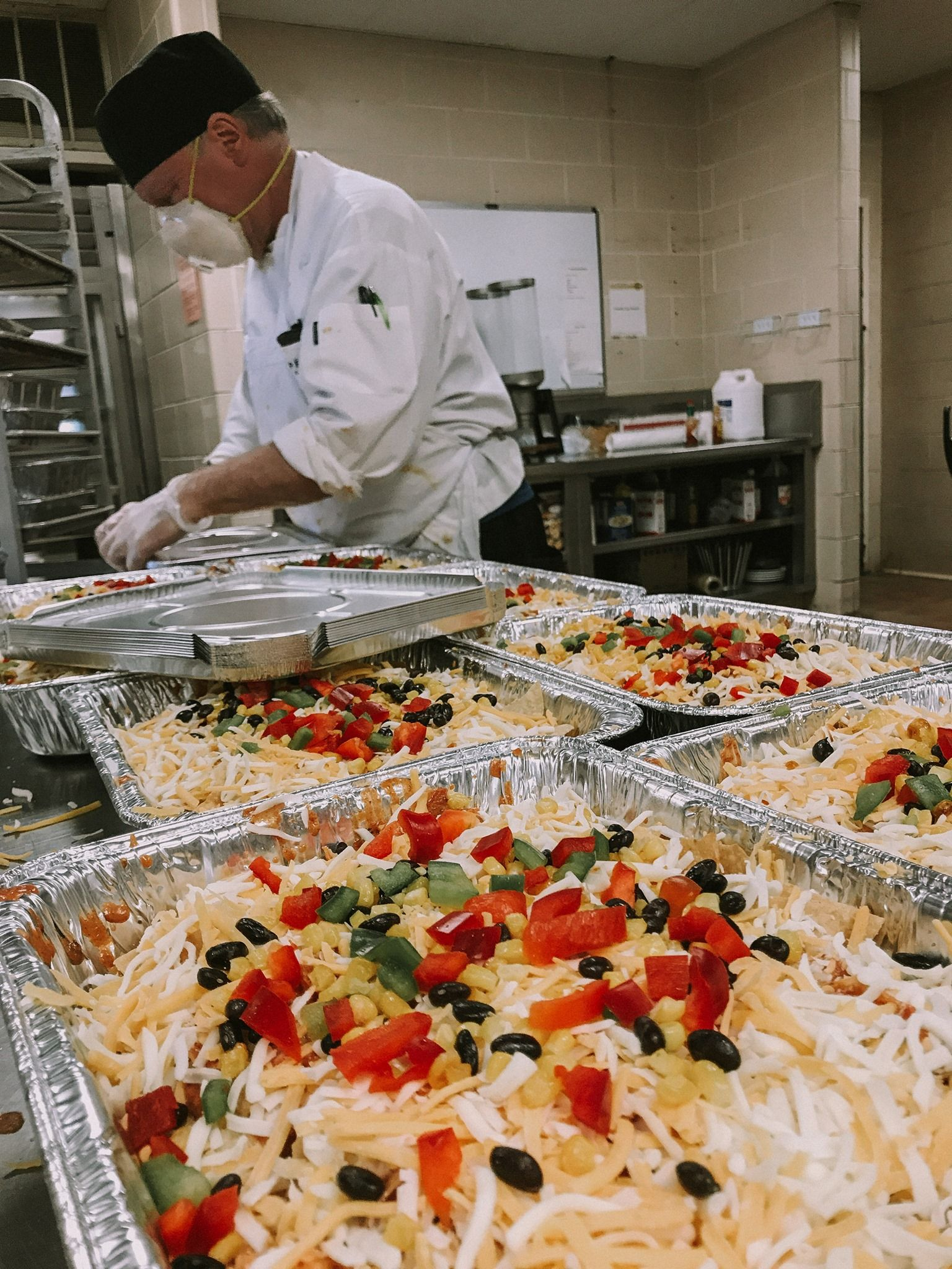 Bon Appetit, in partnership with Wheaton College, is delivering meals to Northwestern Medicine Central DuPage Hospital healthcare workers. Here they are preparing the meals. The new program allows businesses or organizations to purchase meals for front-line people/people otherwise affected by COVID.