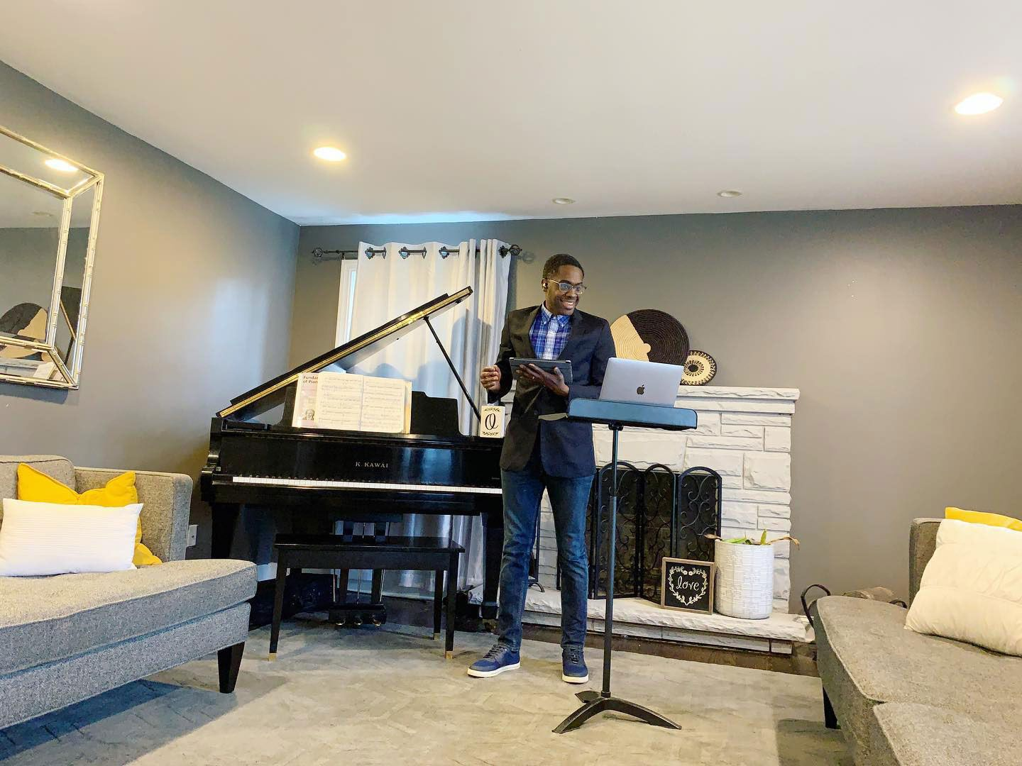 """Wheaton College Conservatory of Music professor Dr. Shawn Okpebholo hosting his first [virtual] Aural Skills II class from home. """"It was so great to see my student's faces. We had 100% attendance from all four times zones."""""""