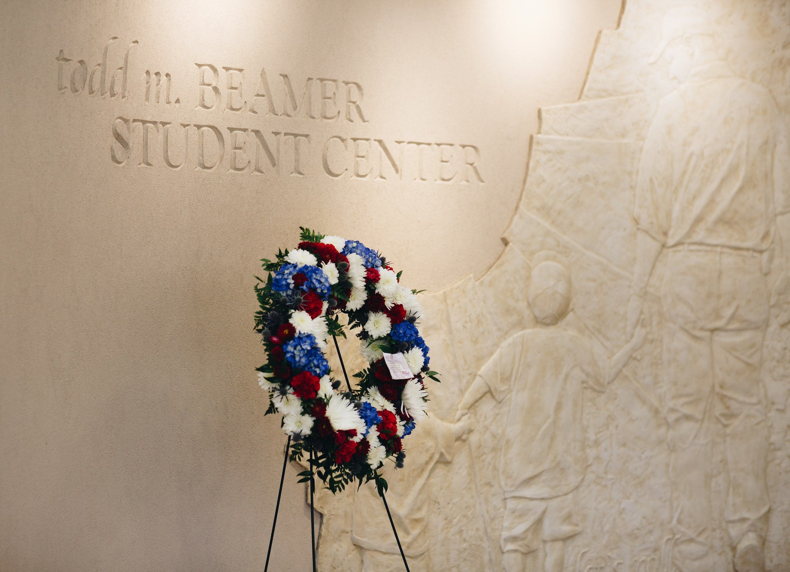 """On 9/11, a wreath is displayed in the Todd M. Beamer Student Center near the bas-relief likeness of Beamer with his sons, and the engraved words: """"Let's roll."""""""
