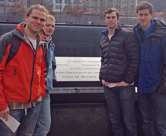 In 2014 student Grant Duncan '15 and his classmates left campus for a 2,150 mile spring break trip that encompassed 12 states and one Canadian province. They went to Boston, Niagara Falls, and New York. They are pictured here, taking a moment at the 9/11 memorial in New York, where they found the name of Todd M. Beamer '91. Pictured here, from left to right: Gregory Conarroe '15, Ian Treat '15, Grant Duncan '15, and Chris Kime '15.